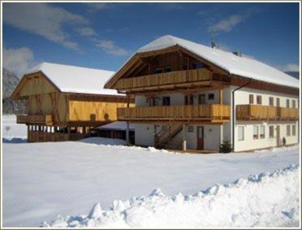 Foto invernale di presentazione Appartamenti in agriturismo Liebharterhof