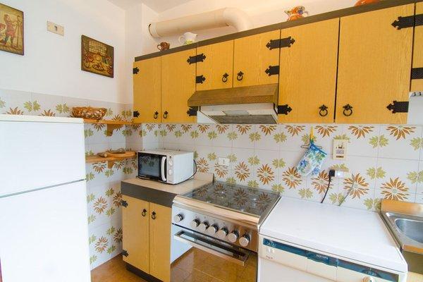 Foto der Küche Residenza Katinanna