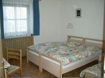 Foto vom Zimmer Ferienwohnungen Suttrú