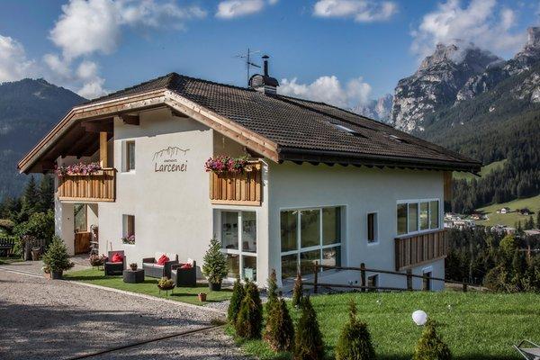 Photo exteriors in summer Apartments Larcenei