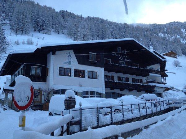 Foto invernale di presentazione Garni-Hotel + Residence Wildbach