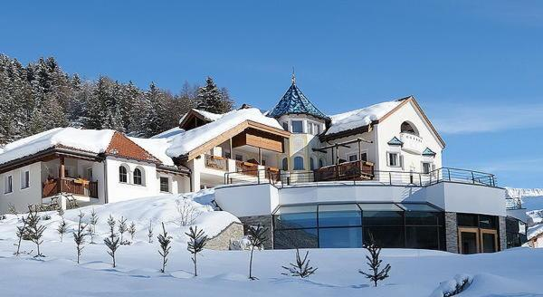 Photo exteriors in winter Alpenheim Charming & SPA Hotel