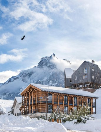 Photo exteriors in winter Hotel Apartments Alpenroyal