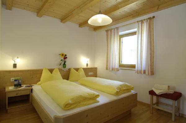 Foto della camera Appartamenti in agriturismo Aichbühlerhof