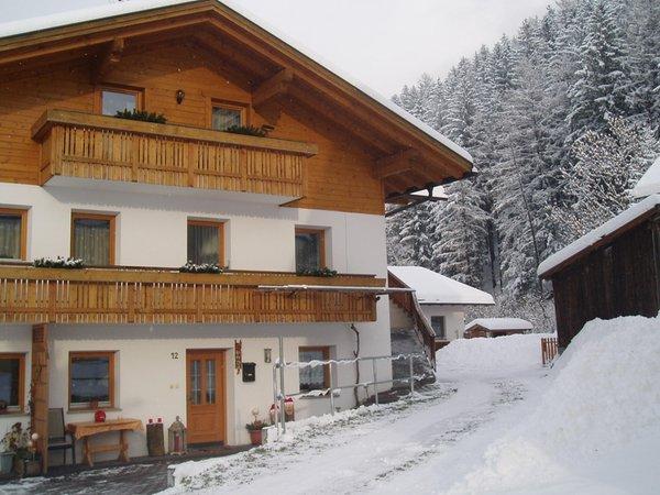 Winter Präsentationsbild Ferienwohnungen auf dem Bauernhof Mesnerhof