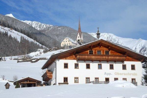 Foto invernale di presentazione Oberachrain - Appartamenti in agriturismo 3 fiori