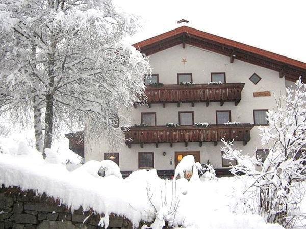 Foto invernale di presentazione Ausserhof - Appartamenti in agriturismo 2 fiori