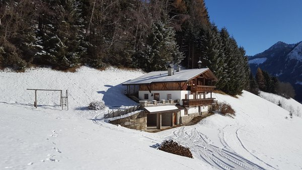 Foto invernale di presentazione Grossgasteigerhof - Appartamenti in agriturismo 3 fiori
