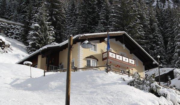 Winter Präsentationsbild Ferienwohnungen Villetta Pordoi