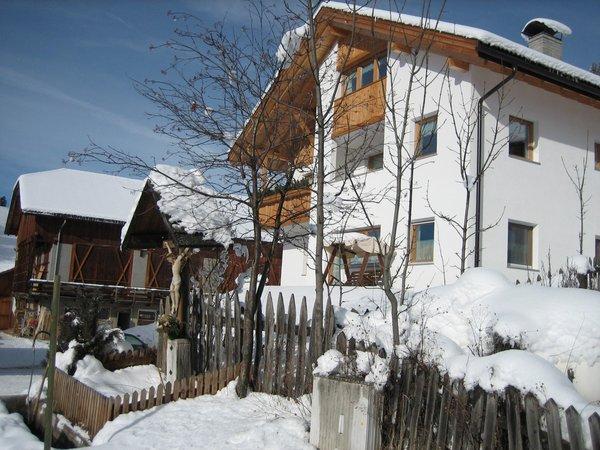 Foto invernale di presentazione Appartamenti in agriturismo Tolpei