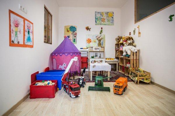 La sala giochi Appartamenti in agriturismo Hofer Hof
