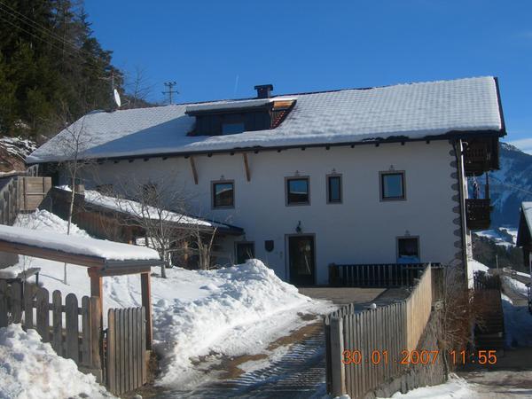 Foto invernale di presentazione Appartamenti in agriturismo Oberpiskoihof