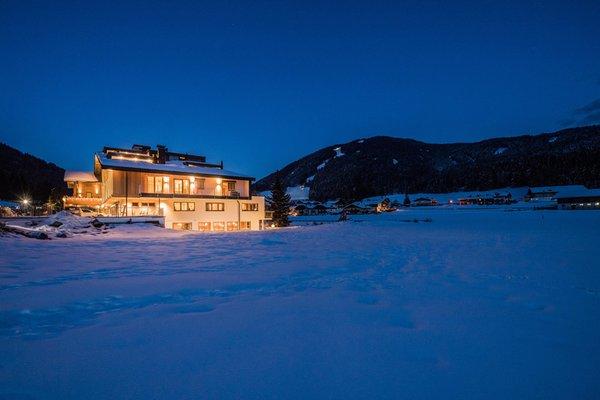 Foto Außenansicht im Winter Helmhotel