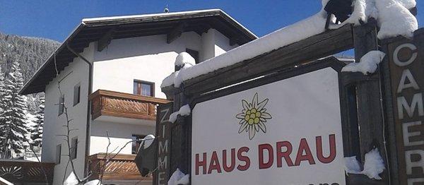 Foto invernale di presentazione Haus Drau - Camere private con prima colazione 2 soli