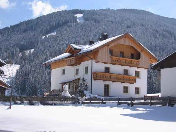 Foto invernale di presentazione Mangerhof - Appartamenti in agriturismo 4 fiori