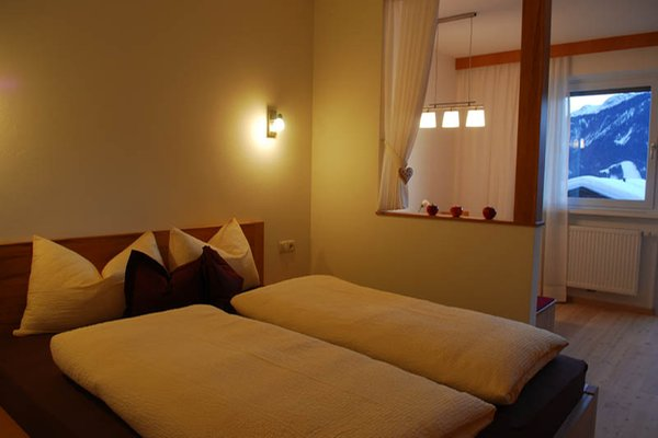Foto della camera Garni (B&B) + Appartamenti Sunnseit'n