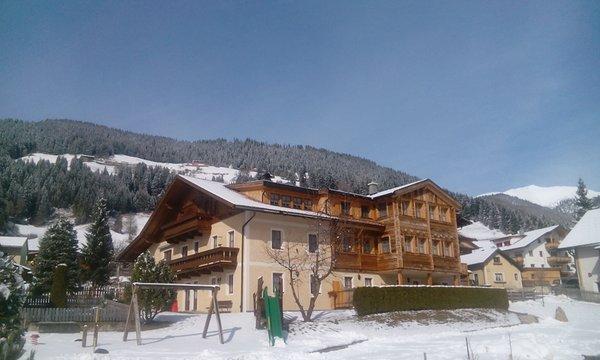 Foto invernale di presentazione Hirschenhof - Appartamenti in agriturismo 3 fiori