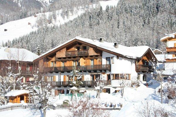 Foto invernale di presentazione Haus Hubertus - Camere private + Appartamenti 3 soli
