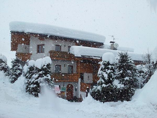 Foto invernale di presentazione Chalet Brigitte - Camere + Appartamenti