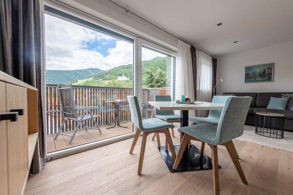 La zona giorno Lapis Monti - Apartments & Suites