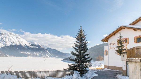 Foto invernale di presentazione Garni + Appartamenti Froy