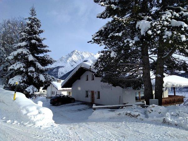 Foto invernale di presentazione Spinhof - Appartamenti in agriturismo 2 fiori