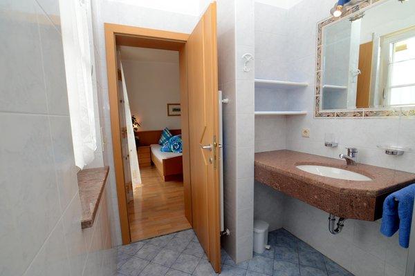 Foto del bagno Appartamenti in agriturismo Rosengartenhof