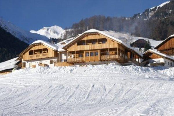 Foto esterno in inverno Pension Odles