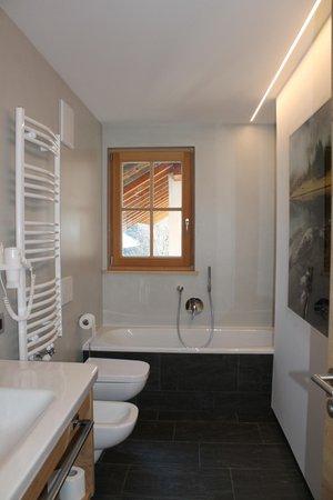 Foto del bagno Appartamenti in agriturismo Natur Lüch Sossach