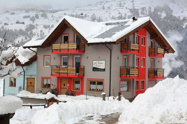 Foto invernale di presentazione Baita Scaia - B&B + Appartamenti