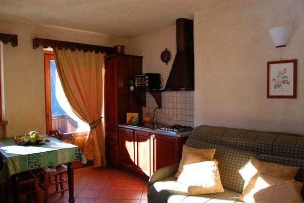 La zona giorno R.T.A. Foyer d'Antan e Dipendenza - Residence 3 stelle