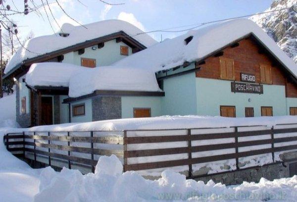 Winter Präsentationsbild Berghütte mit Zimmern Poschiavino