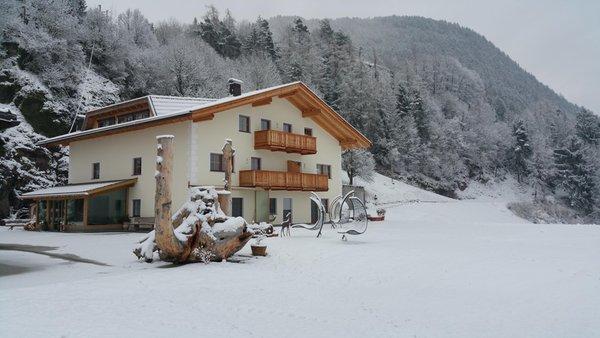 Foto invernale di presentazione Appartamenti in agriturismo Moarlhof