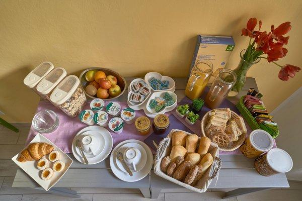 La colazione La Malvasia - Bed & Breakfast