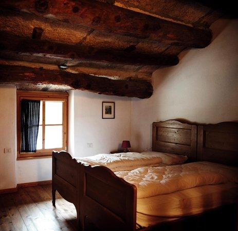 Foto della camera Camere + Appartamenti in agriturismo Malga Riondera