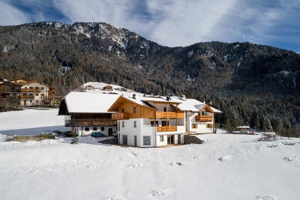 Foto invernale di presentazione Putzerhof - Appartamenti in agriturismo
