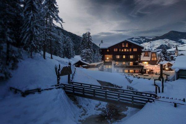 Foto Außenansicht im Winter Aqua Bad Cortina - hotel & thermal baths