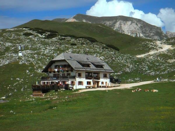 Photo exteriors in summer Mountain hut Sennes