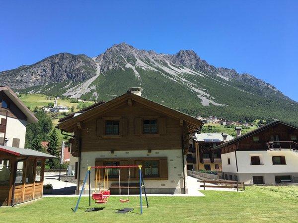 Photo exteriors in summer Rosengarden Alpine Residence