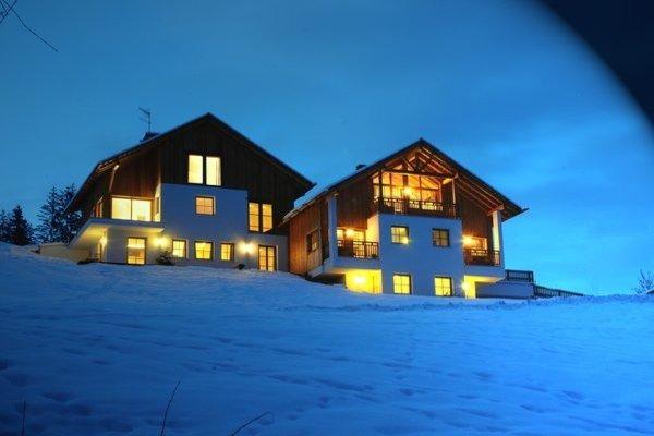 Foto invernale di presentazione Appartamenti Agriturismo Maso Runch-Hof