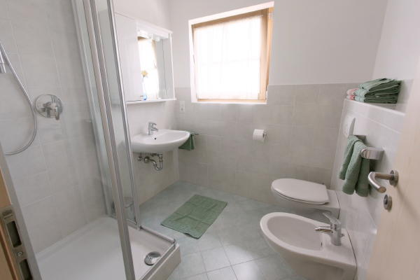 Foto del bagno B&B + Appartamenti Im Winkl