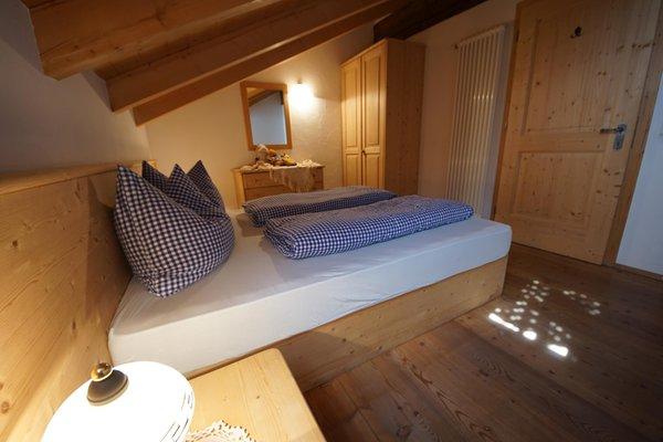 Foto vom Zimmer Ferienwohnungen auf dem Bauernhof Osteria Plazores - rustic sleep