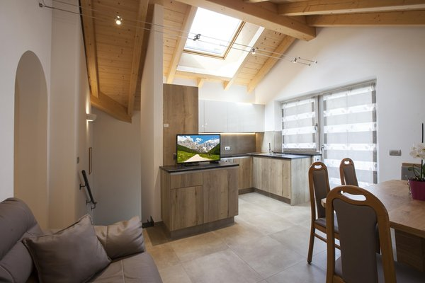 La zona giorno Fiemme Home Mountain Apartment