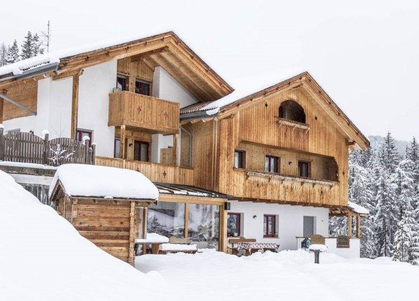 Foto invernale di presentazione Garni + Appartamenti Ciasa Urban