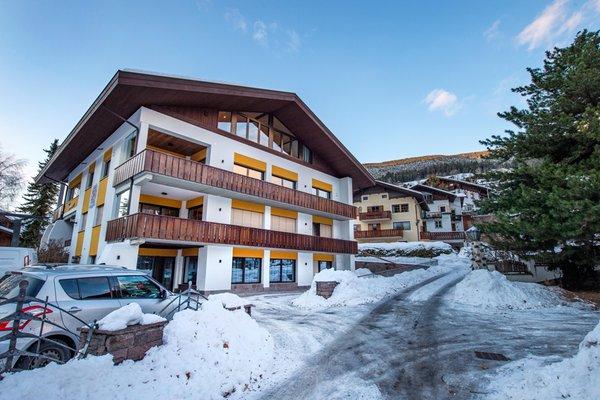 Foto invernale di presentazione Appartamenti Rumanon