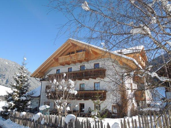 Foto invernale di presentazione Appartamenti in agriturismo Hintnerhof