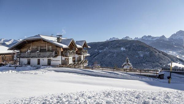 Foto invernale di presentazione Appartamenti in agriturismo Unterguggenberghof