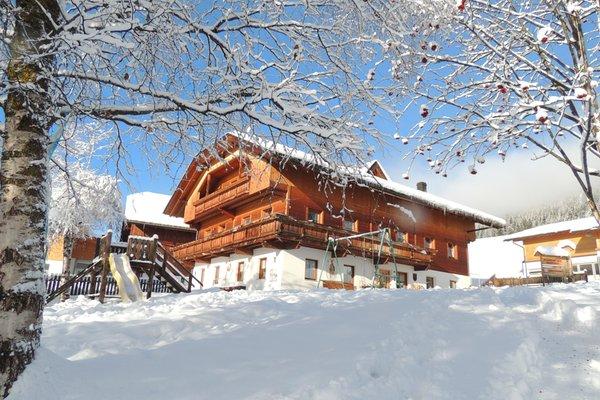 Foto invernale di presentazione Appartamenti in agriturismo Schmözlhof