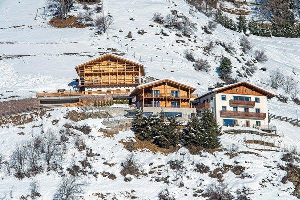 Foto invernale di presentazione Agriturismo Luech da Perteut - Panorama & Wellness